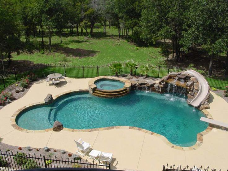 Swimming Pool, Slide, Diving Board, Hot Tub, And Waterfall.