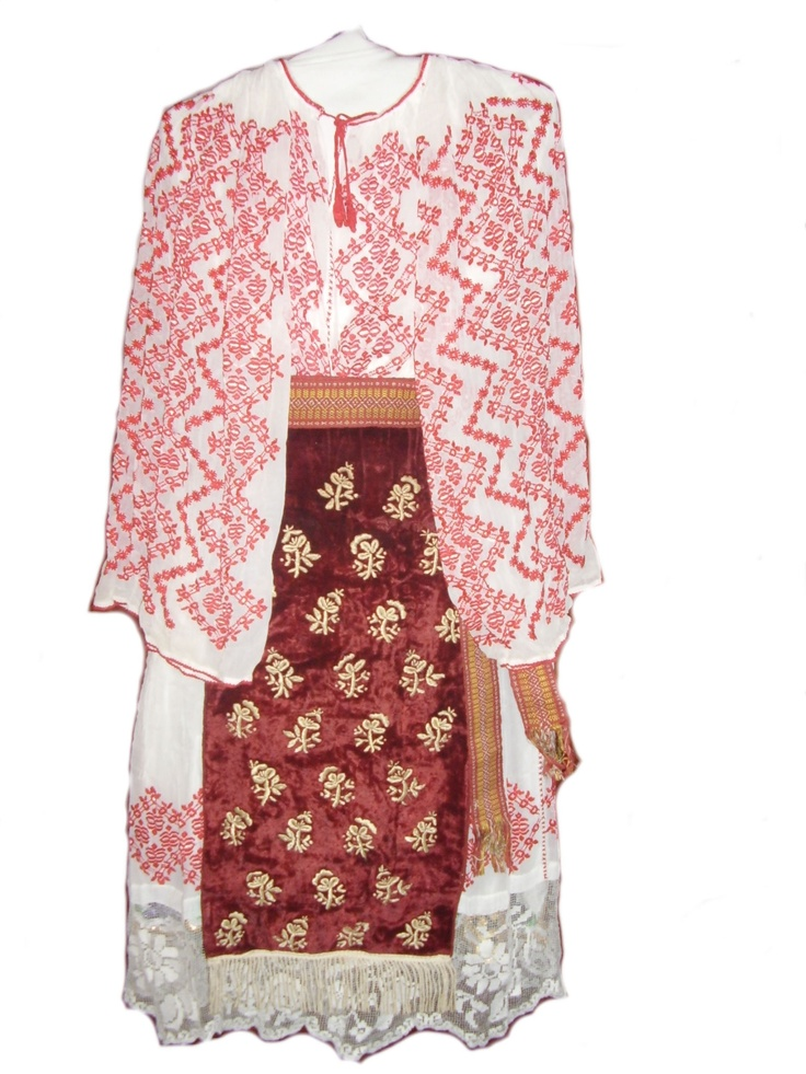 Folk costume from Banat hills region, velvet aprons, linen shirt and skirt, sewed with geometrical shapes and fillet lace.  romanian
