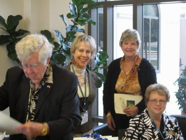 Registration desk team Kathryn Young & Gloria Grenier with Tom Halbert & Gayle Maxey at the International Sustainability & Aquaculture conference