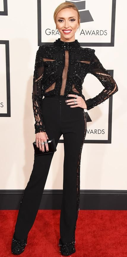 2015 Grammy Awards: GIULIANA RANCIC Giuliana Rancic in a black jumpsuit, Suzanne Kalan diamond earrings, Le Vian diamond rings, Chimento diamond rings, and Louboutin shoes.