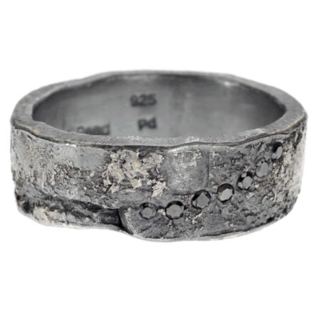 I like that this kind of looks like someone could have just dug it up out of the ground, but there are still little sparkly diamonds, too. This would also be a great man ring.