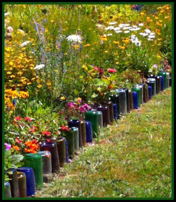 upside-down wine bottles as a colorful garden edging. Very cool.
