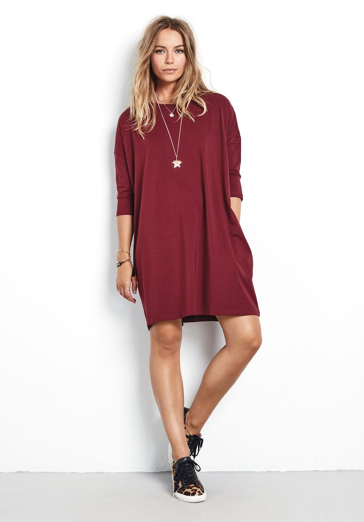 "A modern take on the T-shirt dress, the oversized style creates a cocoon shape that's super stylish and so easy to wear. Keep the look simple and pair with ankle boots. •Sits above the knee, with a drop hem at back. •Two side pockets. •Oversized cocoon shape. Designed to be a loose, relaxed fit. Try your usual size. •Scoop neck with elbow length sleeves. •Model is 5'7"" and wears size XS."