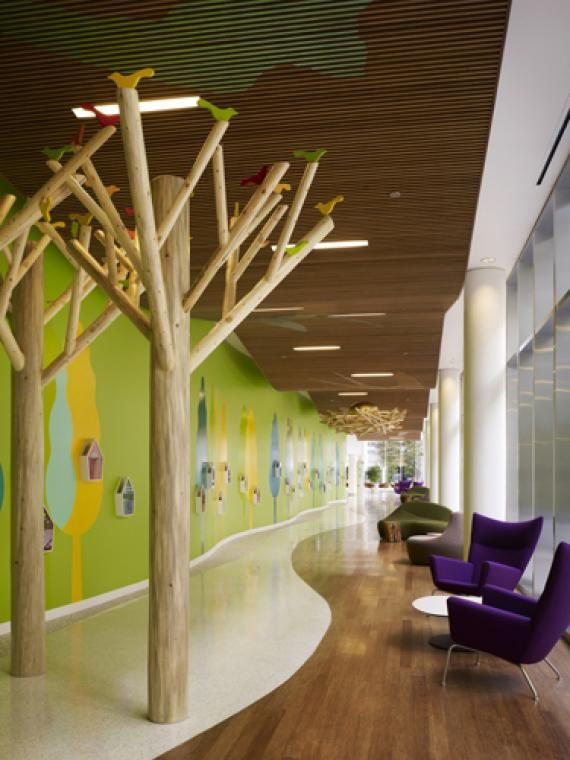 A gallery space with floor-to-ceiling glass connects the main lobby to the existing hospital featuring a nature-inspired art installation. Photo: Nick Merrick