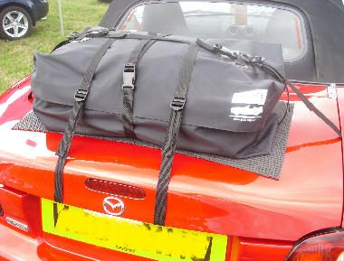 Just a quick email to let you know what an excellent product the Boot-Bag has proved to be. My wife and I drove nearly 1300 miles around France over half-term in our MX5, and the Boot-Bag was first class. We were staying in a variety of locations [almost a different one each night] and not only did the Boot-Bag provide plenty of extra capacity, but the webbing strap harnesses etc proved easy to attach/detach.
