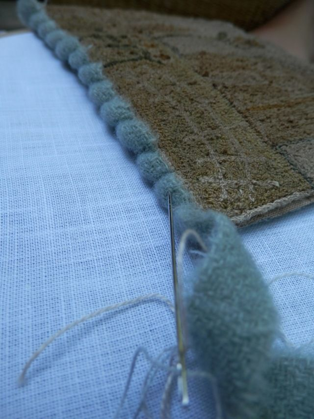 Edge Finished With Wool Strips And Stitches