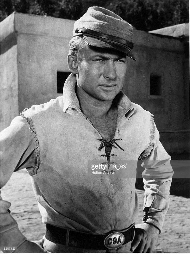 1959: American actor Nick Adams (1931-1968) poses in costume as Johnny Yuma from the television series, 'The Rebel'. He holds his hands on his hips, wearing a Civil War cap and uniform.