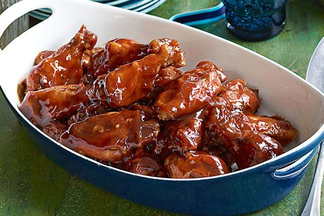 Try out these Slow-Cooker Party Wings at your next get-together! Seasoned with honey and OJ, these slow-cooker wings are simple crowd-pleasers.
