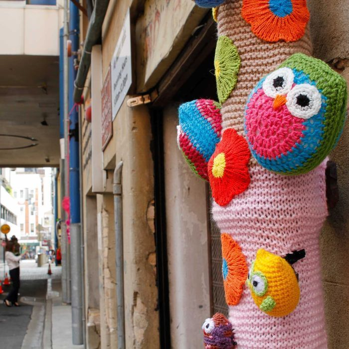 Amigurumi yarn bomb - Turtles, owls and teddy bears are hiding in the nooks and crannies of Brisbane's Burnett Lane.