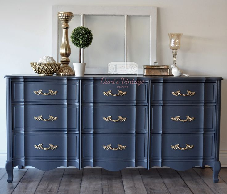 I LOVE this solid Malcolm 9 drawer french provincial long dresser. Perfect as a buffet / sideboard, TV stand, baby change station in a gender neutral navy nursery, entry way table, you name it. These dressers are always sturdy and never disappoint. What makes them so unique is those ripples on the drawer fronts. Painted using Benjamin Moore Advance in Hale Navy and handles spray painted in a gold shade to tie in with the bold look. – R Bilodeau