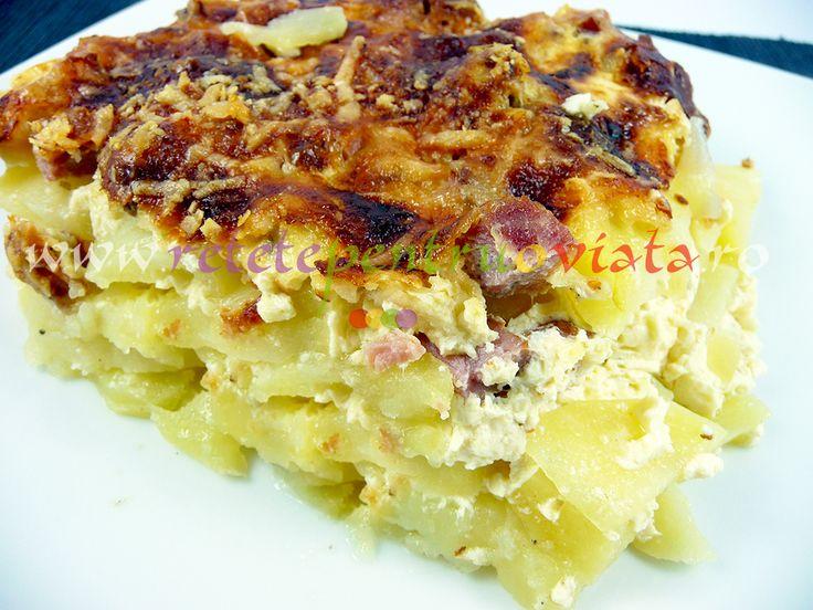 Reteta de budinca de cartofi cu sunca si cascaval - o mancare rapida si usoara care se poate consuma fie ca aperitiv, fie ca fel principal.