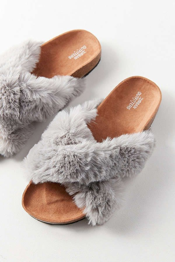 ffceec718 Modern glamour queen meets low key Cali-cool with these faux fur slide  sandals, available exclusively at UO. Featuring a dramatically fluffy  crisscrossed, ...