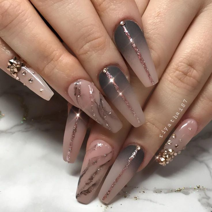 Gradient dark to nude polish with glitter and bling ballerina nails