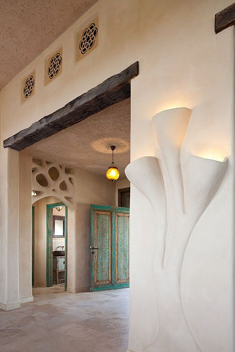 Integrated lights, decoration and timber above door frame