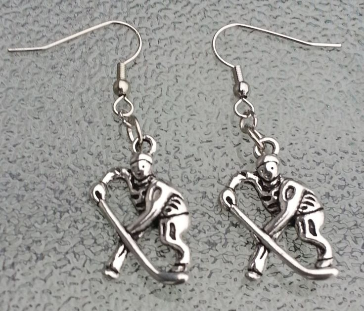 These are silver metal 26 mm hockey player earrings perfect for the hockey fan in your life! They are made of silver metal hockey players and nickel free and hypo allergenic hooks. Like my Facebook pa