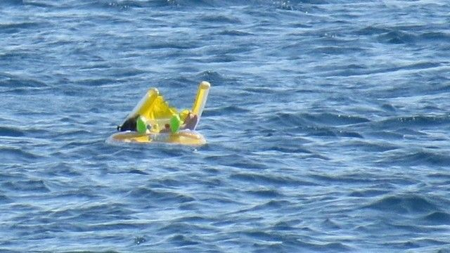 Ten month old baby rescued after drifting 1km out to sea – video | World news | The Guardian