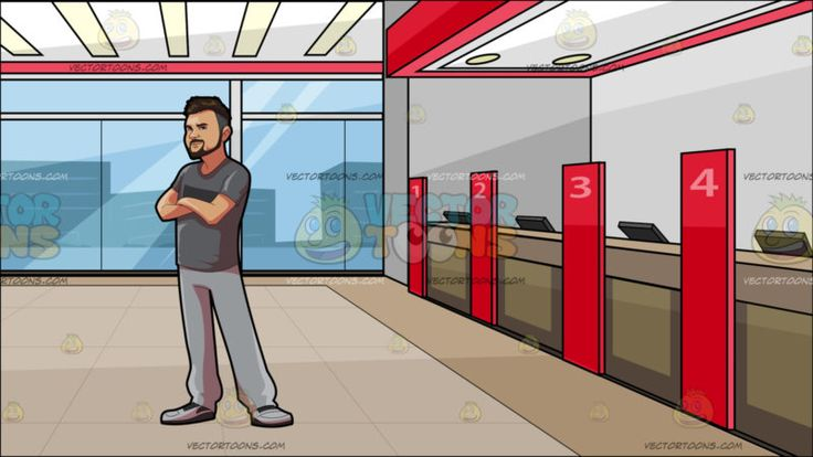 A Man Wearing His Casual Clothes Has His Arms Crossed At Inside A Local Bank :  A man with brown short mohawk style hair beard and mustache wearing a gray shirt light gray pants and sneakers smirks while crossing his arms on his chest. Set in inside a bank with light gray walls lighted ceiling with red accent light brown counters with the numbers one to four on red dividers black monitors per counter glass windows and beige flooring.