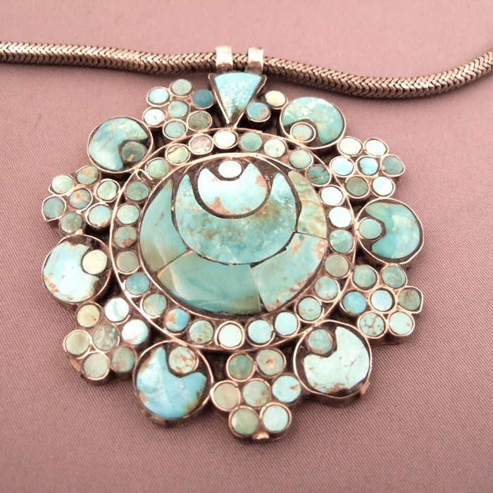 India | An old silver and turquoise pendant from Kashmir. The crescent design is typically Muslim | © Michel Halter.