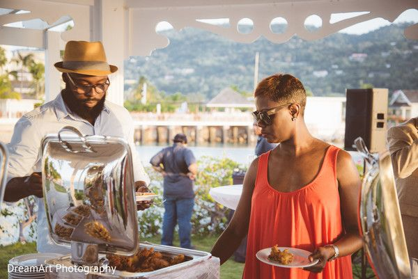 Guests help themselves to the buffet at the wedding reception   Moon Palace Jamaica Grande #destinationwedding