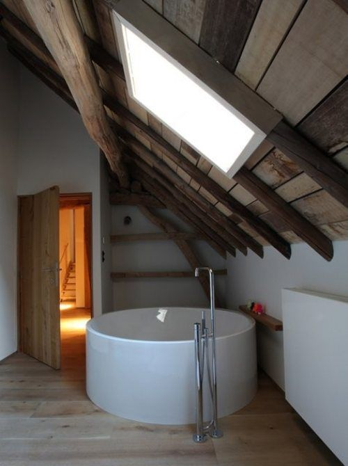 House DM (Rabbit Hole) in Belgium / by LensAss architecten (photo by Andri  Haflidason). attic space, cyclindrical tub under a skylight.