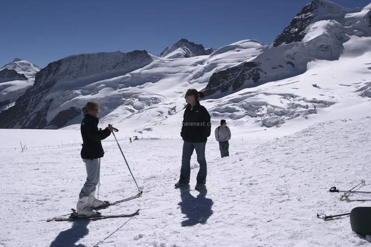 Swiss Alps - Skiers on the mountain   #switzerland #lucerne #adventure #snow #alps #fun #experience #interesting #travel #traveltherenext #mountain #train