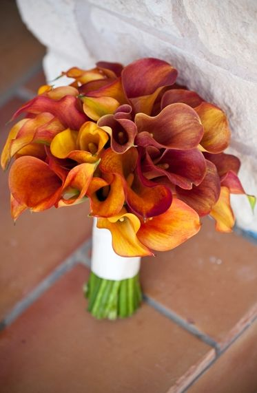 Lovely burnt orange bouquet with reds & yellows mixed in.