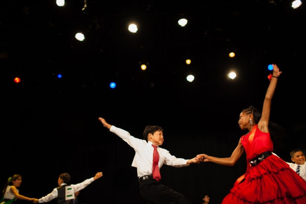 Students dance in the last round of the Dancing Classrooms Grand Final competition at the Cocoanut Grove Theater on June 19, 2012.