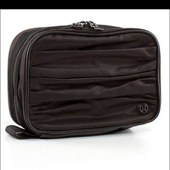 ❌SOLD❌Lululemon gym essentials travel kit black NWT. Tag is not attached to the item & the price was cut off the bottom of the tag to prevent me from knowing the gift amount. The last image is to show how much you can pack into this kit.  The item I'm selling is Black NOT Purple as in the last picture! Small enough to fit in any gym bag; large enough to fit your entire beauty routine. Removable clear pouch fits most 100ml containers & easily wipes clean. Stowable hook hangs in lockers or…