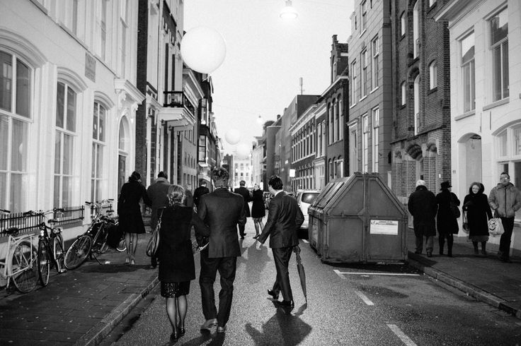 Street picture, wedding guests, Groningen, suits, dresses, formal, chique, fashion. Photo by Sjoerd Banga, © Banganimation