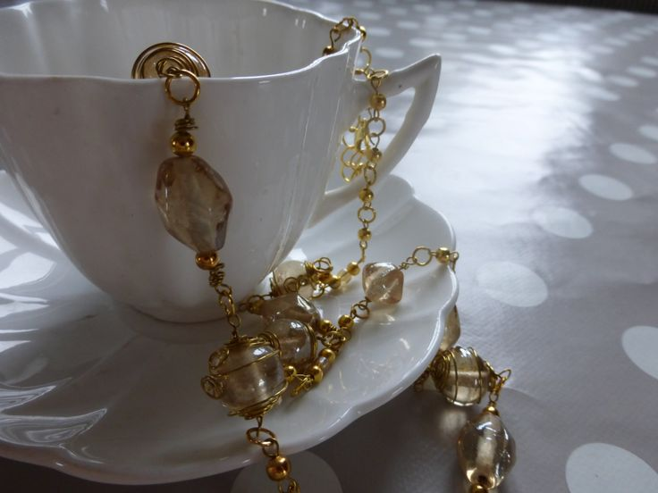 Necklace: Glass champagne beads encased in gold spirals by TheCatAndTheClasp on Etsy