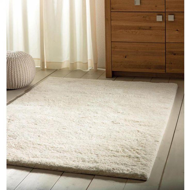 Hófehér kézicsomózású szőnyeg! Tökéletes kényelmet biztosít,társasozni a legalkalmasabb hely.