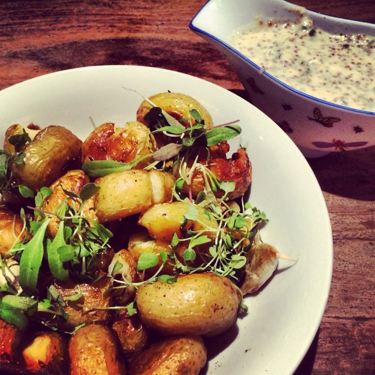 Baby potatoes served with micro herbs & yogurt and mustard vinaigrette.