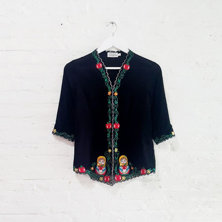 Mary Matryoshka 001  IDR 895.000  Open for Pre-Order  Estimated Work Days : 7 – 10 working days  Mary Matryoshka Hand Embroidery Contemporary Long Sleeve Kebaya  Length of Kebaya : (Front) approx. 70 cm / (Side) approx. 56 cm  Material used : Textured Chiffon / Hand Embroidery  Note: Inner Wear is not included with the Kebaya