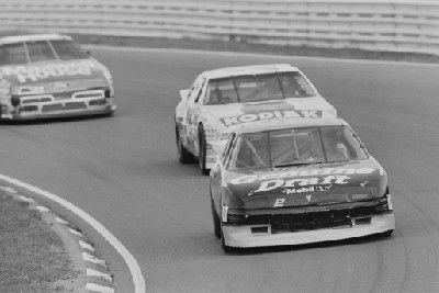 Car number 2 Pontiac Grand Prix driven by Rusty Wallace, followed by car number 25 Chevrolet Lumina driven by Ken Schrader, followed by car number 22 Ford Thunderbird driven by Sterling Marlin