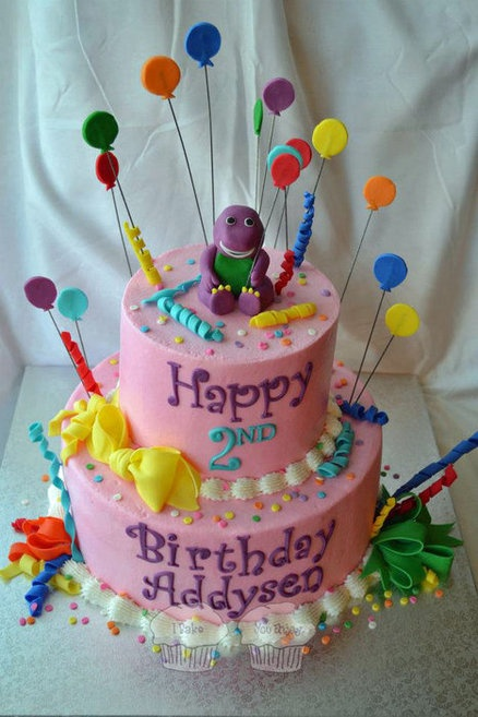 Barney Birthday Cake. If she's still into Barney in December :)