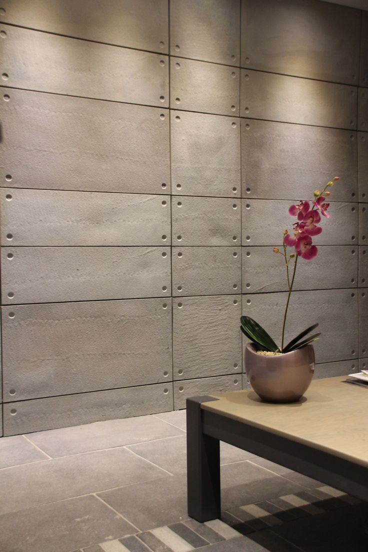 Modern, sleek, durable and contemporary off shutter cladding in plain grey. Ideal for any business or home wall area.