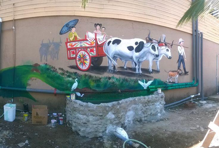 pintando murales en la pared del Centro Demostrativo de Sostenibilidad. Guacimal. Tema del día de San Isidro el Santo Patrono de los trabajadores. Painting on the Sustainability Demonstration Center`s walls at Guacimal. The topic is about the day of San Isidro the saint of the workers.