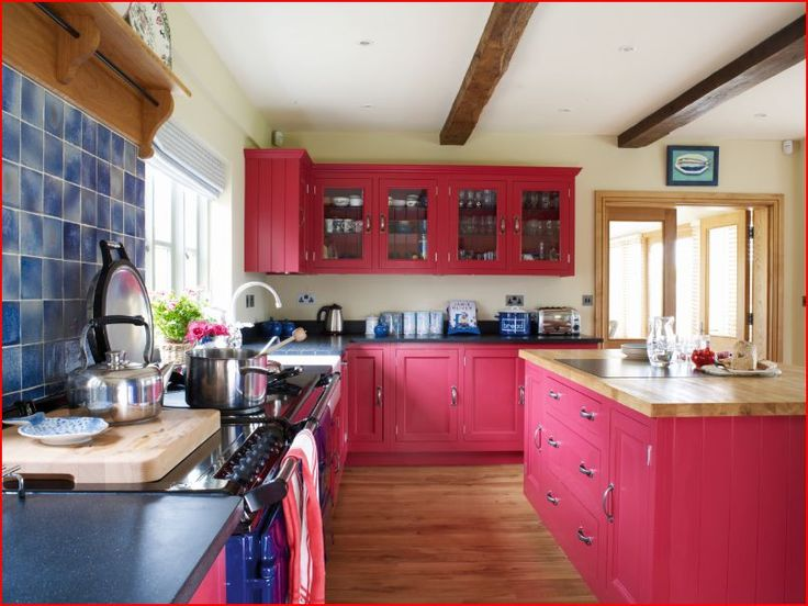 Bright, bold and very pink! A shaker kitchen doesn't have to be white at Parlour Farm.