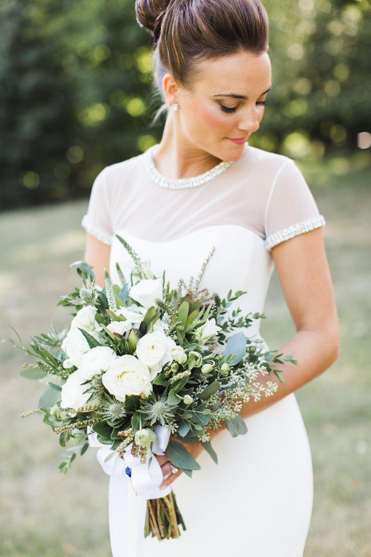 Ranunculus and thistle wedding bouquet: Hair and Makeup: Annaliese & Co - http://www.stylemepretty.com/portfolio/annaliese-and-co Wedding Dress: Suzanne Neville - http://www.suzanneneville.com Photography: Ashley Caroline Photography - ashley-caroline.com   Read More on SMP: http://www.stylemepretty.com/2017/04/26/industrial-beacon-new-york-wedding/
