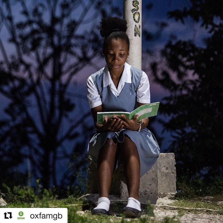 """#Repost @oxfamgb  Sephora reads her book under a solar powered street lamp. Together with the other children Sephora uses the solar lamp to do her homework in the evenings. Before the solar panels I used to study with an oil lamp or a torch. It was very difficult because you are holding this little torch in your hands and you cant even see properly it was not comfortable to study like that."""" Oxfam has installed 50 solar powered lamps in public spaces in Port au Prince Following the 2010…"""