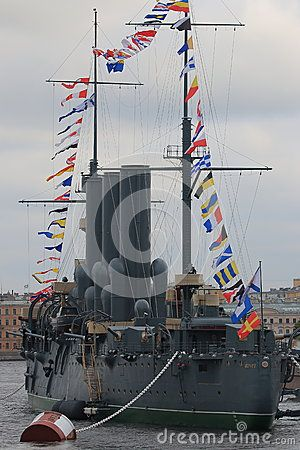 Back view of the historic cruiser Aurora on a cloudy day. Saint-Petersburg…
