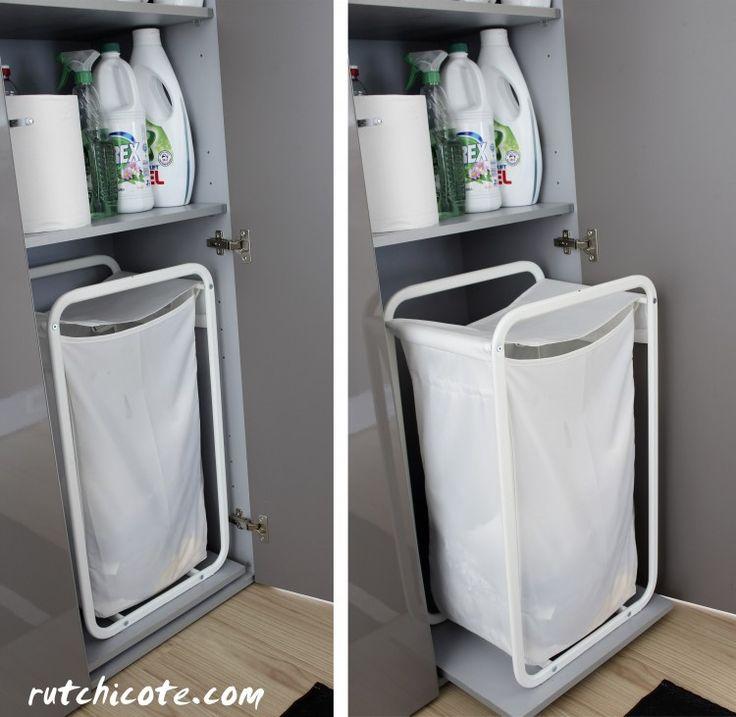 Detalle: cesto de la ropa sucia accesible, puesto encima de un panel extraíble.