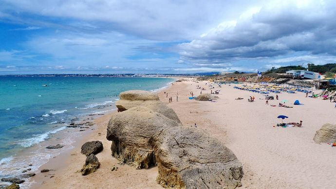 Visit Gale Beach, a beach with an extensive mantle of golden sand in Albufeira, Algarve   Portugal.  The beach of Gale is divided by a cliff, the Western end of Gale extends to the Salgados beach, while the beach of East Gale is confined by cliffs except at low tide during summer months.  http://goo.gl/kCggLn #algarve #tourism #beaches #algarvetouristguide