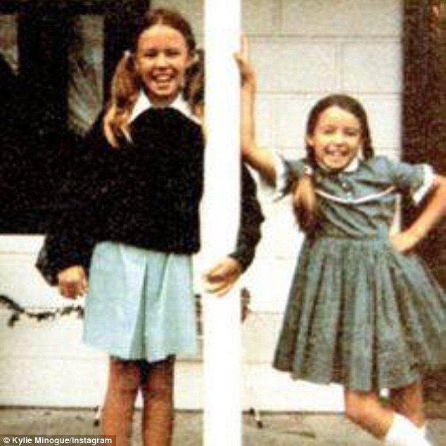 Not much as changed! Kylie Minogue shared a sweet childhood photo of herself and sister Da...