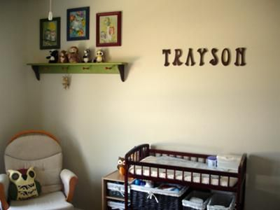 The nursery's wall shelf and framed  owl themed artwork that I painted and my baby boy's name spelled in letters. I made most of our baby boy's owl nursery decor myself including the baby bedding.  I wanted to do an owl themed nursery for my third boy, but couldn't