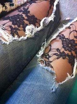 Lace stockings under ripped jeans
