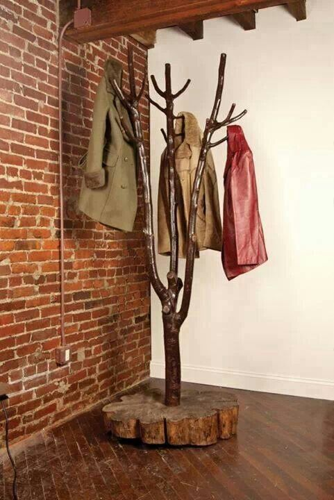 Take a large branch and use a slab cut from a stump fore the base and Vola..... you have a Coat Tree.
