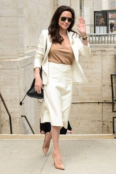 April 24 2015 For a United Nations Security Council meeting in New York, she wore a white skirt suit and a camel chemise and matching heels.