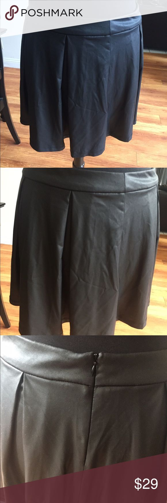 Black Faux Leather Skater Skirt - Soft, flowy💋 Black Faux Leather Skater Skirt - Soft, flowy💋 Good for Fall and Winter. Easy to pack. Wore this in Medoc France on a trip. Pair with sweaters💋 Forever 21 Skirts