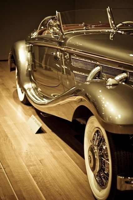 Well, this is one way to get around town: try a Gold Vintage Automobile...or not !!! :)))
